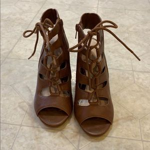Brown lace up heels.
